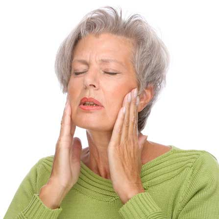 Senior lady holding her mouth in pain