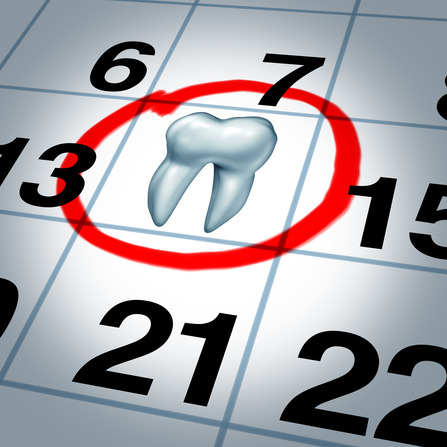 Dentist appointment and dental check up health care concept as a month calendar with a tooth circled