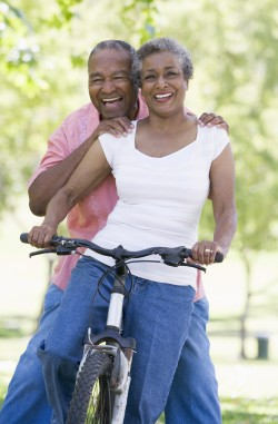 Happy old age couple in cycle