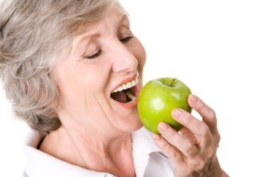 Old age women eating apple